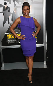 Montego Glover chose this ruffled royal purple cocktail dress for her look at the 'Now You See Me' premiere in NYC.