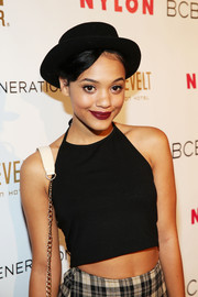 Kiersey Clemons jazzed up her look with a black hat at the Nylon + BCBGeneration May Young Hollywood Party.