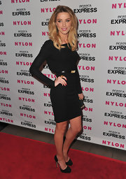 Amber looked sophisticated and sexy in a slinky black cocktail dress with the pvc and suede, platform Marlo pumps.