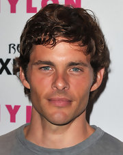 James showed off shirt curls while walking the red carpet at the Nylon and Express party.