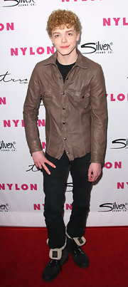 Cameron Monaghan looked rugged in black fur-lined lace-up boots at Nylon Magazine 12th Anniversary Issue Party.