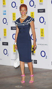 Kelis sported a sailor inspired navy dress while attending the Clef Awards in London.