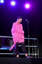 Demi Lovato performed at the 'Demi Lovato: Dancing with the Devil' premiere wearing an oversized pink polka-dot blouse by Balenciaga.
