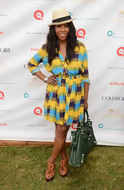 June Ambrose pulled off a stylish outdoor ensemble featuring brown strappy platforms at the Annual Super Saturday.