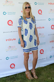 Nicky opted for a relaxed-fit white and blue mini dress for the OCRF Super Saturday event.
