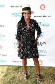 June Ambrose sported a black-and-white peace sign-print dress during OCRFA's Super Saturday.