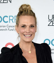 Molly Sims attended OCRFA's Super Saturday wearing her hair in a high bun.