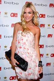 Socialite Tinsley Mortimer toughened up her flirty floral look with a black leather clutch with silver grommets.