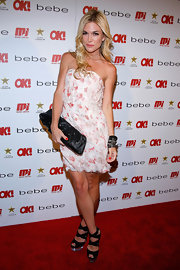Tinsley rocked out her floral mini dress with black accessories and a hot pair of strappy, peep-toed sandals with clear platforms.