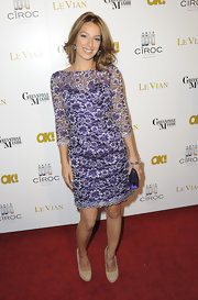 Vanessa complemented her purple floral dress with nude platform pumps.