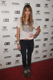 Sharni wears a worn-in tee with black jeans and boots for the Ok! Magazine party.
