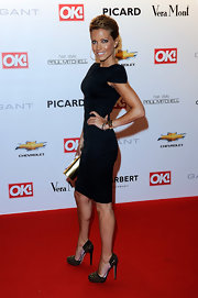Sylvie van der Vaart added a metallic gold clutch that looked fabulous with her studded heels.