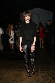 Coco Rocha teamed embroidered skinny pants with a tux jacket for the Omega Speedmaster Dark Side of the Moon event.