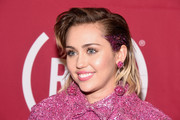 Miley Cyrus channeled her dad with this mullet at the ONE Campaign and (RED) concert to mark World AIDS Day.