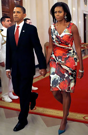 Blue kitten heels complement the colors in Michelle Obama's Diane Von Furstenberg floral print dress.