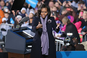 A patterned scarf added some brightness to Michelle Obama's all-black attire.