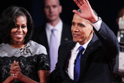 U.S. President Barack Obama (R) waves on stage with first lady Michelle Obama after the debate  at the Keith C. and Elaine Johnson Wold Performing Arts Center at Lynn University on October 22, 2012 in Boca Raton, Florida. The focus for the final presidential debate before Election Day on November 6 is foreign policy.