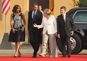 The First Lady looked chic in this silver and purple, swirl-print frock with two bow details at the straps.