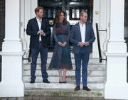 Kate Middleton complemented her frock with blue suede pumps by Rupert Sanderson.