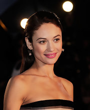 Olga Kurylenko's bright pink lipstick looked super feminine and fun on the actress.