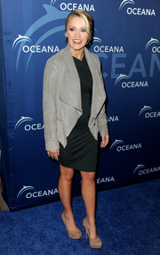 Emily Osment arrived at Oceana Partners Awards Gala wearing a stylish gray suede jacket over her cocktail dress.
