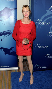 Melanie Griffith kept it modest with a red cardigan layered over a simple cocktail dress during the Oceana Partners Awards Gala.