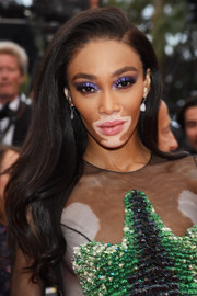 Winnie Harlow wore her hair down with a side part and just the slightest wave at the 2019 Cannes Film Festival screening of 'Oh Mercy!'