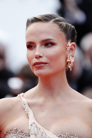 Natasha Poly styled her hair into a twisted bun for the 2019 Cannes Film Festival screening of 'Oh Mercy!'