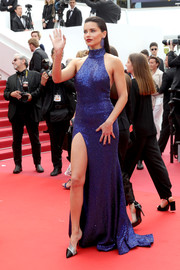 Adriana Lima looked dazzling in a shimmering cobalt halter gown by Michael Kors at the 2019 Cannes Film Festival screening of 'Oh Mercy!'