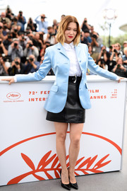 Lea Seydoux polished off her outfit with a black mini skirt, also by Louis Vuitton.