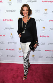 LuAnn added a touch of fierce to her fashion week ensemble with these sassy zebra print slacks.