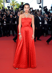 Bella Hadid cut a sweet picture in a quilted red gown by Christian Dior Couture at the Cannes Film Festival screening of 'Okja.'