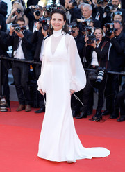Juliette Binoche looked angelic in a white Chloé gown with a high neckline and bishop sleeves at the Cannes Film Festival screening of 'Okja.'