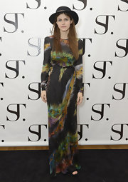 Alexandra Daddario rocked the boho chic look in a peacock print maxi dress at the grand opening of the SuperTrash Flagship Boutique.