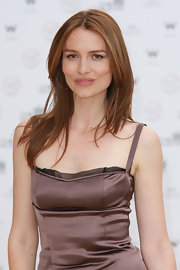 Saffron Burrows sported a simple-yet-sophisticated center-part layered hairstyle at the Old Vic Theatres Trust summer fundraiser.