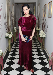 Dita Von Teese looked flawless, as always, in a wine-colored velvet gown at the Olgana Paris cocktail party.