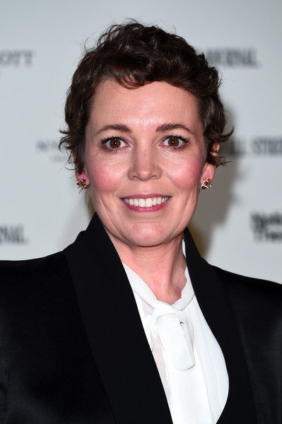 Olivia Colman Short Curls [hair,white-collar worker,hairstyle,smile,suit,premiere,official,businessperson,red carpet arrivals,olivia colman,london,england,the national theatre,up next gala]