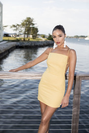 Olivia Culpo was summer-sexy in a backless yellow mini dress at the Kendra Scott event.