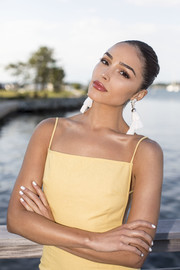 Olivia Culpo attended the Kendra Scott event sporting a white mani.