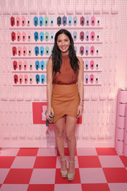 Olivia Munn attended the opening of Target Tribeca wearing a sleeveless burnt-orange blouse by Mossimo.