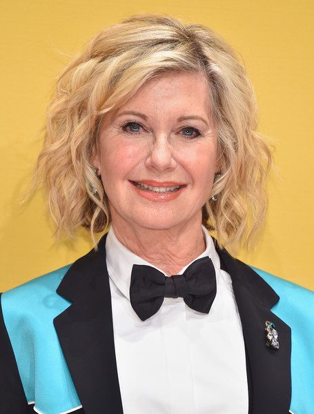 Olivia Newton-John Curled Out Bob [hair,human hair color,blond,hairstyle,beauty,smile,formal wear,white collar worker,official,long hair,arrivals,olivia newton-john,cma awards,nashville,tennessee,bridgestone arena,olivia newton-john,grease,country music association awards,singer,actor,united states of america,concert]
