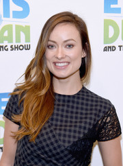 Olivia Wilde wore her layered waves loose and swept to the side during her visit to 'The Elvis Duran Z100 Morning Show.'