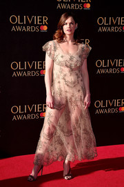 Ruth Wilson complemented her dress with rhinestone-adorned diagonal-strap sandals by Olgana.