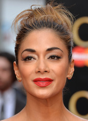 Nicole Scherzinger polished off her look with a red-hot pout.