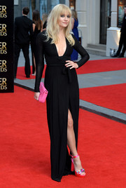 Pixie Lott got a little playful with her accessories, choosing a pair of chunky, bejeweled platform sandals by Sophia Webster and a hot-pink clutch by Fendi.