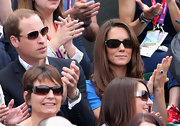 Kate Middleton's sleek oval sunnies added modern panache to her look.