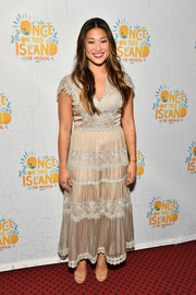 Jenna Ushkowitz looked very ladylike in a nude maxi dress with white lace trim at the Broadway opening of 'Once on This Island.'