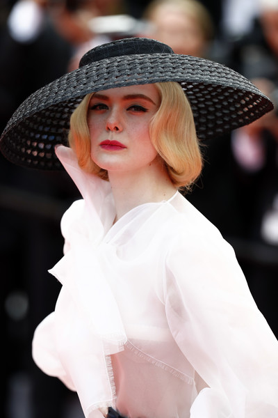 Elle Fanning looked dramatic wearing this black wide-brimmed hat by Dior Couture at the 2019 Cannes Film Festival screening of 'Once Upon a Time in Hollywood.'