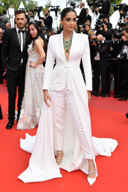 Sonam Kapoor complemented her suit with strappy white pumps by Jimmy Choo.