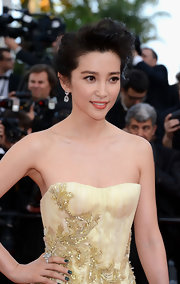 Li Bingbing attended the 'Once Upon a Time Premiere' with her nails painted a deep forest green shade.
